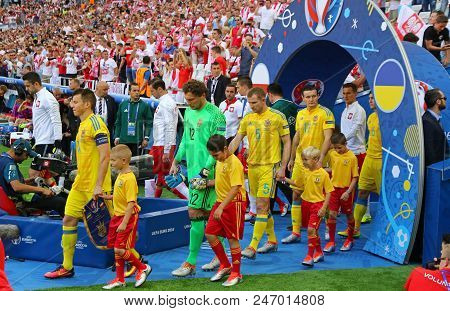 Marseille, France - June 21, 2016: Ukrainian (in Yellow) And Polish Players Go To The Pitch Before T