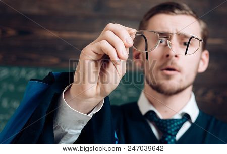 Let Me See. Teacher Formal Wear And Glasses Looks Concentrated, Chalkboard Background. Chalkboard Fu