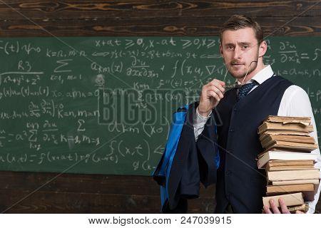 Clear Explanation. Teacher Formal Wear And Glasses Looks Smart, Chalkboard Background. Chalkboard Fu
