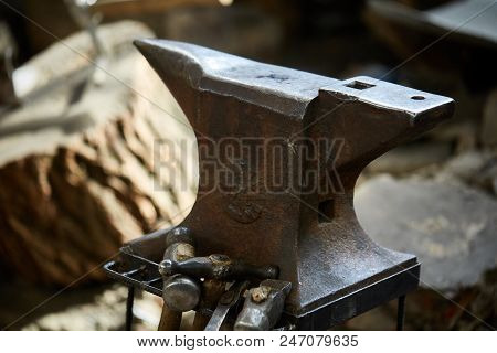 Big heavy anvil in the blacksmith's workshop, close-up, selective focus. Workshop background. Nesessary equipment for succesful manufacturing. Craftsman tools. Labour equipment. Art and crafts concept. poster