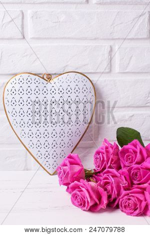 Decorative Heart And Pink Roses Flowers On White Wooden Background Against Wall. Floral Still Life.