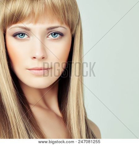 Young Blonde Woman Face Closeup. Female Model With Blonde Hair On Background