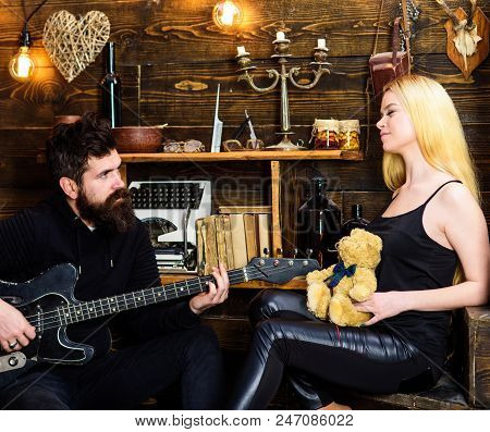 Romantic Date Concept. Couple In Love On Relaxed Faces Enjoy Romantic Atmosphere. Man Play Guitar Wh