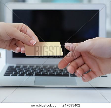Closeup Shot Of A Woman's Hand Giving A Payment Credit Card To The Seller In Computer Store. Girl Ho