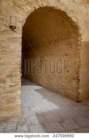 Stone Brick Wall With Aged Vaulted Passage