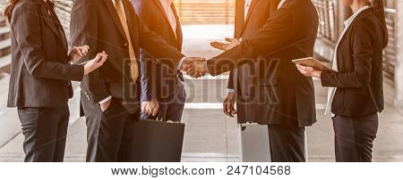 Business People  Handshake Concept. Shaking Hand Of Group Of Businessman Negotiation Closing A Deal