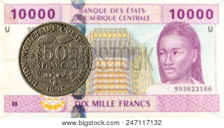 50 Central African Cfa Franc Coin Against 10000 Central African Cfa Franc Bank Note Obverse