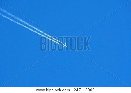 Military Supersonic Russian Fighter Aircraft Flying. Army Plane In The Blue Sky At High Speed.