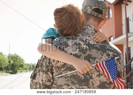 American Soldier Hugging With His Son Outdoors. Military Service