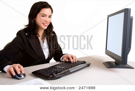 Smiling Business Woman Working On A Computer