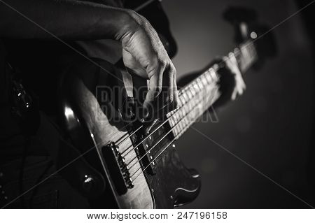 Electric Bass Guitar Player Hands, Live Music Theme, Close Up Black And White Photo