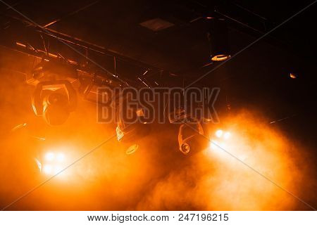 Red Strobe Lights With Strong Beams In Smoke Over Dark Background, Modern Stage Illumination Equipme
