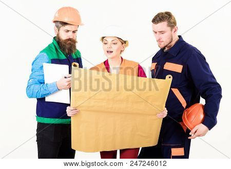 Men And Woman In Hard Hats, Architects On Busy Faces Looks At Drawing, Plan, Blueprint, Project, Whi