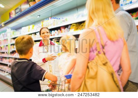 Family At The Supermarket, Talking To Sales Clerk