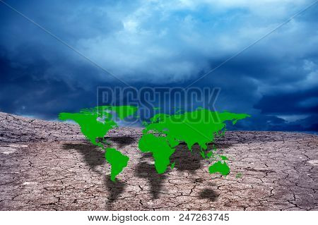 conceptual image of mountain and cracked soil with worldmap