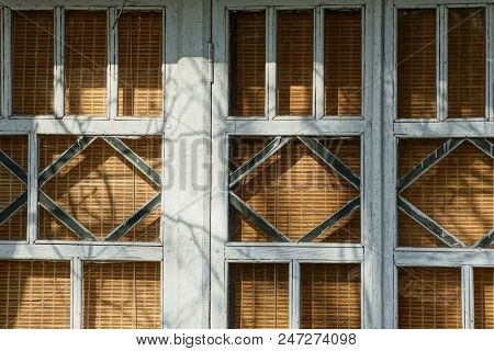 Part Of An Old Wooden Window With A Pattern
