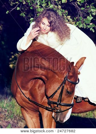 soft portraits of bride rideand her  horse at night poster