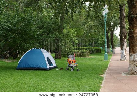 Blue Camping Tent In Park
