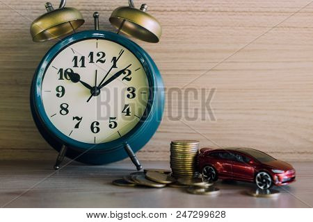 Red Car And Money Coin Stack Growth With Clock