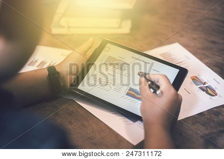 Image Of Young Businessmen Using Touchpad At Meeting