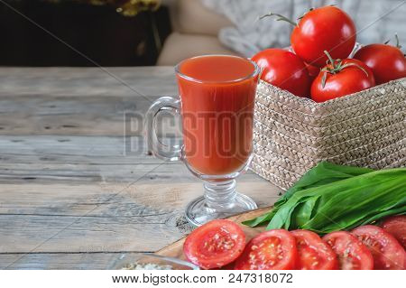 Fresh Tomato Juice In A Glass Glass Glass Glass On A Wooden Table.