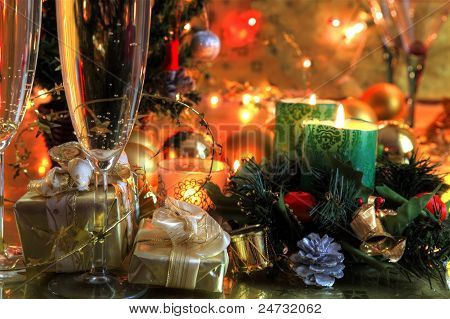 Champagne in glasses and christmas tree.