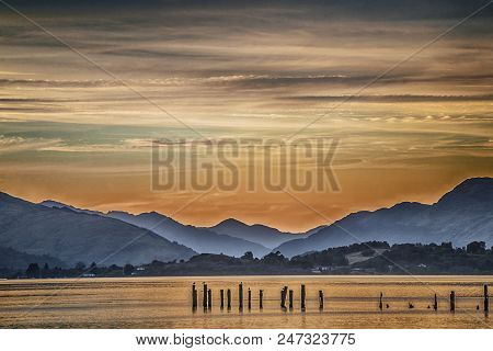 Beautiful Sunset Andscape With Lake Loch Lomond And Hills In Scotland