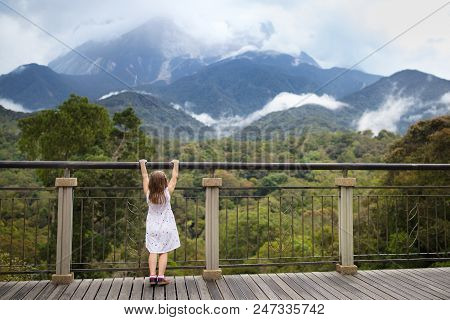 Child Hiking In Mountains