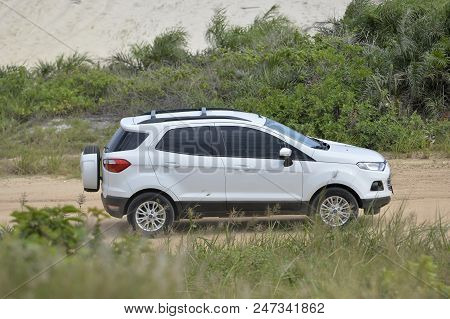Marica, Brazil - March 10, 2018:  Car Passing A Dirt Road, Raising Dust