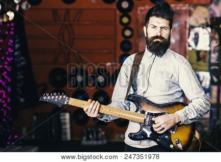 Talented Musician, Soloist, Singer Play Guitar In Music Club On Background. Musician With Beard Play