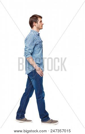 Side view of going  handsome man. walking young guy . Rear view people collection.  backside view of person.  Isolated over white background.  The guy in the plaid shirt goes into his pockets.