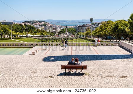 Lisbon, Portugal - May 19, 2017: People Are Resting In The Park And Lisbon City View From Eduardo Vi
