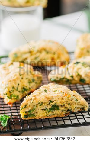 Savory Scones With Feta Mozzarella And Green Herbs On A Wire Rack.