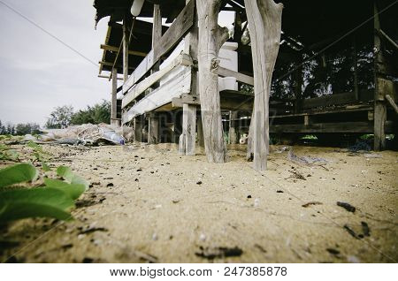 Tranquil Rural Area Near The Seashore, Wooden Fisherman Hut On The Sandy Beach. Fish Net And White I