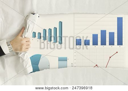 Male Hand Ripping A Paper Sheet Revealing Graphs Showing Growth
