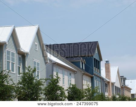 A Rootline View Down One Street In A New Construction Community Shows The Contrast In Styles And Mat