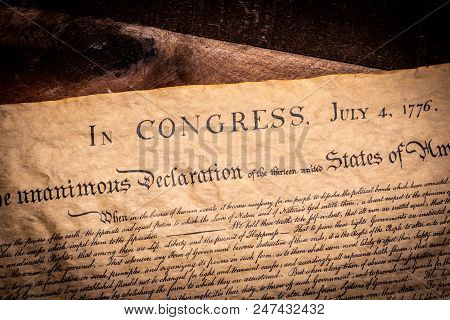 A Copy Of The Declaration Of Independence Of The United States On A Wooden Table