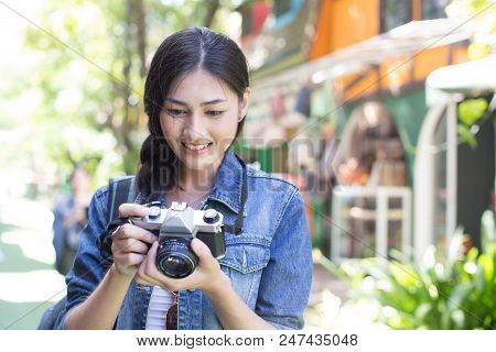 Portrait Of Happy Traveler Woman In City. Asian Women Hold Retro Camera For Take Photo, People With