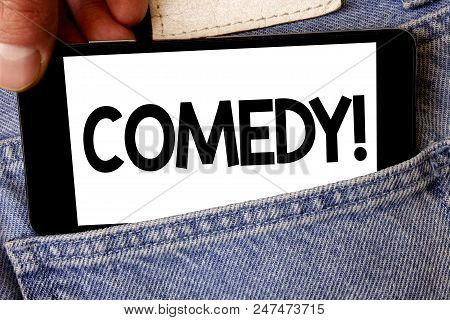 Handwriting text Comedy Call. Concept meaning Fun Humor Satire Sitcom Hilarity Joking Entertainment Laughing Man hold holding cell phone white screen message application technology poster
