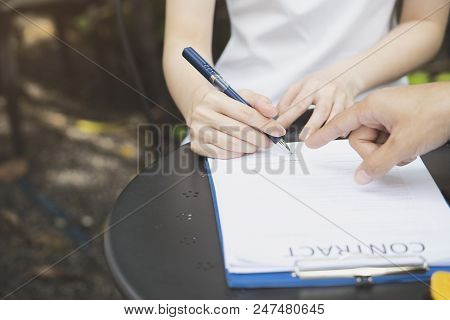 A Businesswoman Is Negotiating A Business Deal Or Contracting And Signing A Contract, Business Negot
