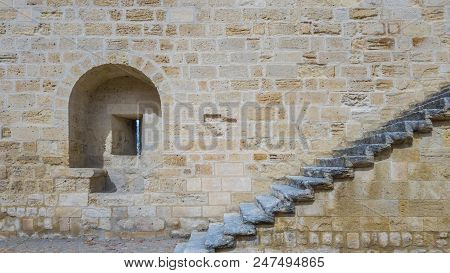 An Embrasure And A Staircase On The Stone Wall Of An Ancient Fortress.