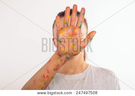 Teenage Girl Covers Her Face With Her Left Palm In Paint