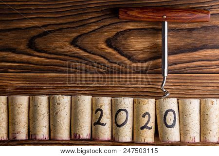 2020 New Year Celebration Background With A Row Of Used Red And White Wine Corks With An Attached Bo
