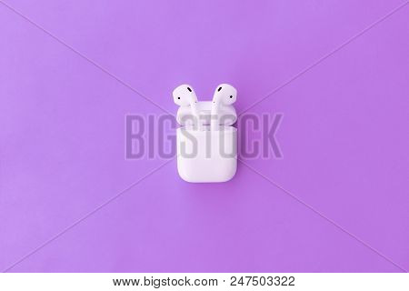 Rostov-on-don, Russia - April 28, 2018: Apple Airpods Wireless Bluetooth Headphones And Charging Cas