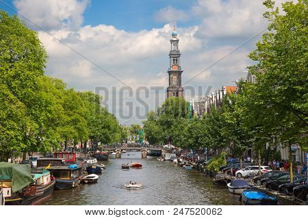 AMSTERDAM - JULY 10: Canals of the Amsterdam city on July 10, 2016 in Amsterdam, Netherlands. The historical canals of the city surrounded by traditional dutch houses is main attraction of Amsterdam.