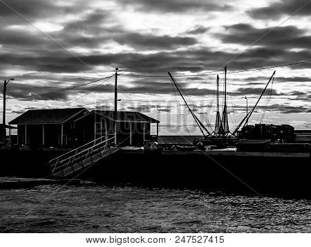 An Artsy View In Black And White Of A Fishing Boat On Prince Edward Island, Canada, With A Cloudy Sk