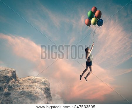 Girl Jumping From A Peak And Fly With The Balloons.