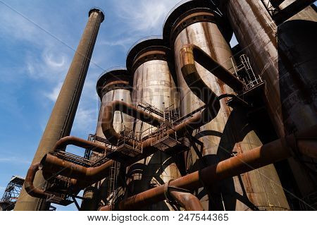 Massive Rusty System Of Tubes And Pipes In Adandoned Industrial Area
