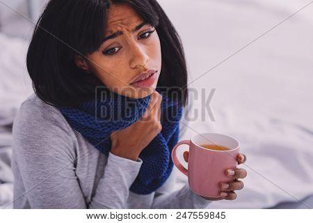 So Sick. Upset Brunette Drinking Tea While Feeling Discomfort In Throat