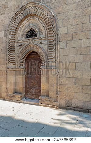 Grunge Wooden Ornate Aged Vaulted Arched Door On Exterior Decorated Stone Bricks Wall, Cairo, Egypt